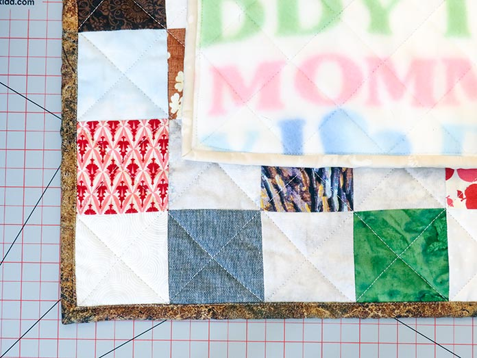 showing the machine binding from the front and back of the quilt
