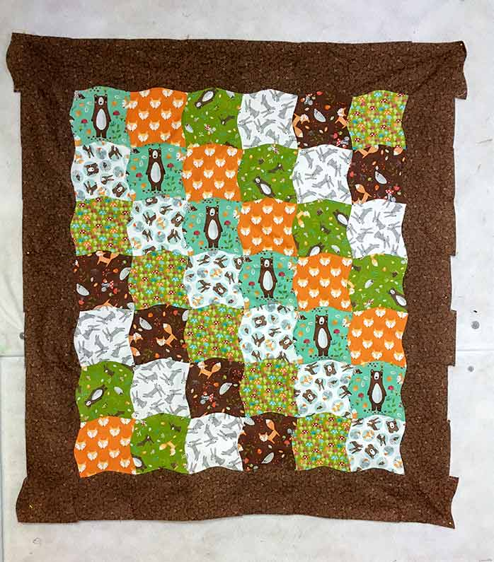 Sew the rows together and the curved border is now visible.