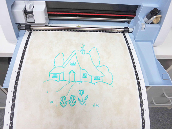 Design is drawn on fabric, Brother ScanNCut SDX225, Brother scanning mat, Brother fabric mat, Brother blue erasable marking pen, Heat n Bond Feather Lite, Brother color pen set