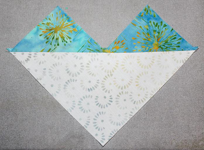 Press open the triangles on each half square unit.