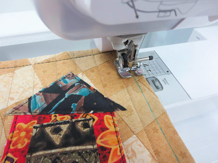 """Top stitching around the outside edge using the hand–look quilting stitch Q–04 on a Brother sewing machine. Brother Innov-ís BQ3050 sewing and quilting machine, Mary Ellen's Best Press, Brother SA185 ¼"""" Piecing Foot with Guide, Brother SA125 ¼"""" Quilting Foot, Olfa square ruler, MuVit digital dual feed foot"""