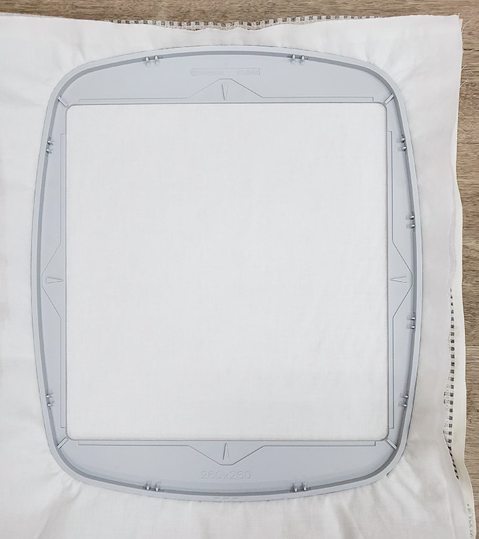 Fabric and stabilizer are shown hooped in the 260 x 260 machine embroidery hoop.
