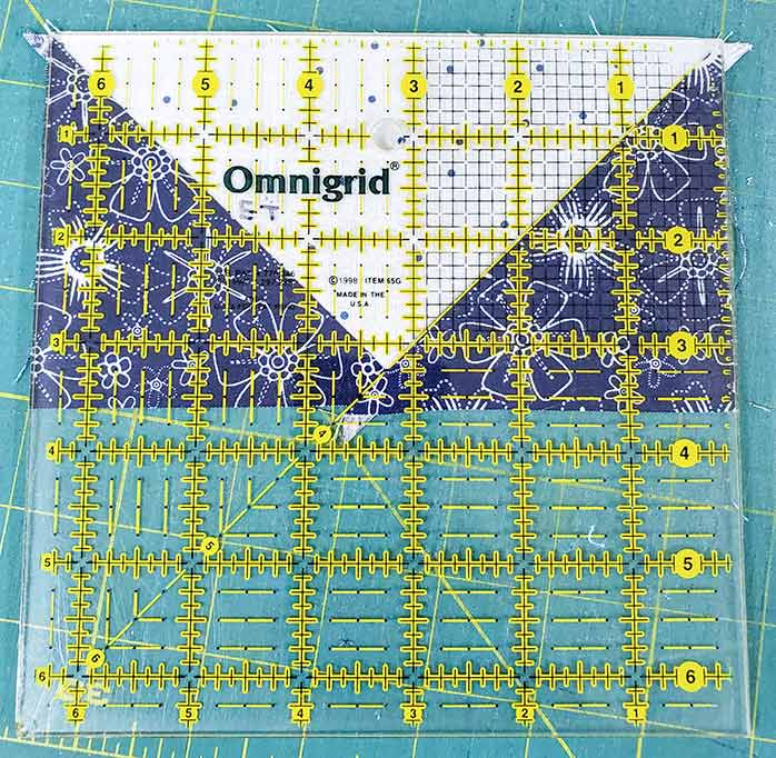 Trimming the flying geese units with a regular ruler; Spectrum QAL2020, Blue Stitch Fabric Collection Block 1