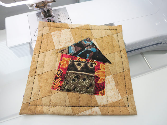 """Finished raw edge applique house mini quilt. Brother Innov-ís BQ3050 sewing and quilting machine, Mary Ellen's Best Press, Brother SA185 ¼"""" Piecing Foot with Guide, Brother SA125 ¼"""" Quilting Foot, Olfa square ruler, MuVit digital dual feed foot"""