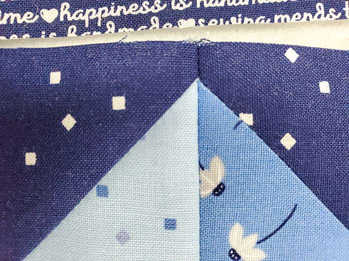 A sharp point on the flying geese unit. Block 3 featuring the Blue Stitch collection by Riley Blake Designs.