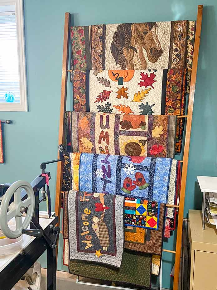 This extra wide blanket ladder is used to store wall hangings.