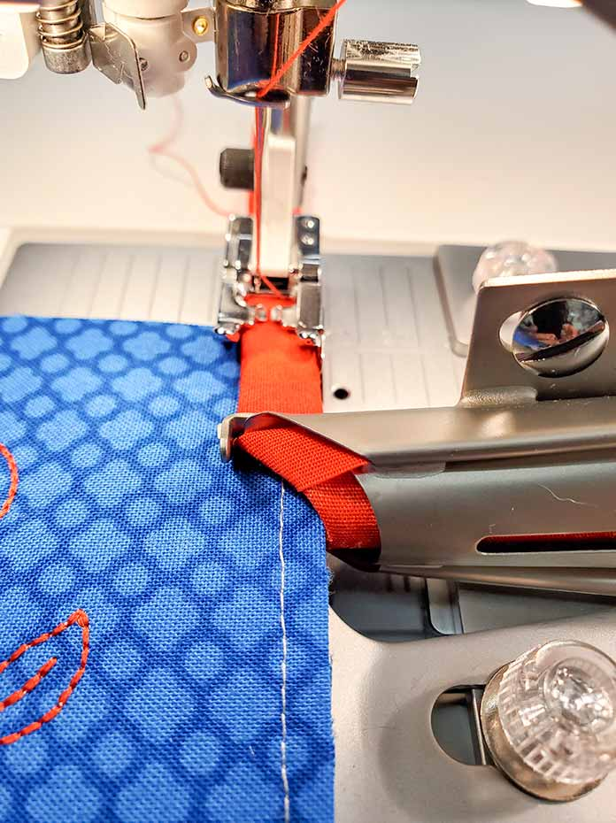 Getting ready to stitch the binding on the pocket of the chair caddy using the Quilt Binder and the Husqvarna Viking Designer Sapphire™ 85