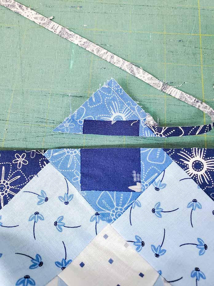 Trimming the edge of the blue and white quilt. Spectrum QAL2020 made with the Blue Stitch collection by Riley Blake Designs