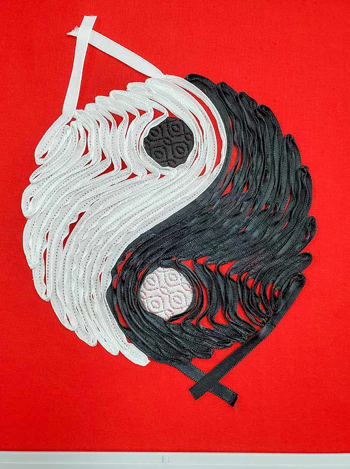 The Yin Yang ribbon embroidery design in black and white.
