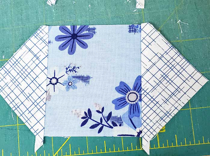The first two seams of the center unit. Block 3 featuring the Blue Stitch collection by Riley Blake Designs.