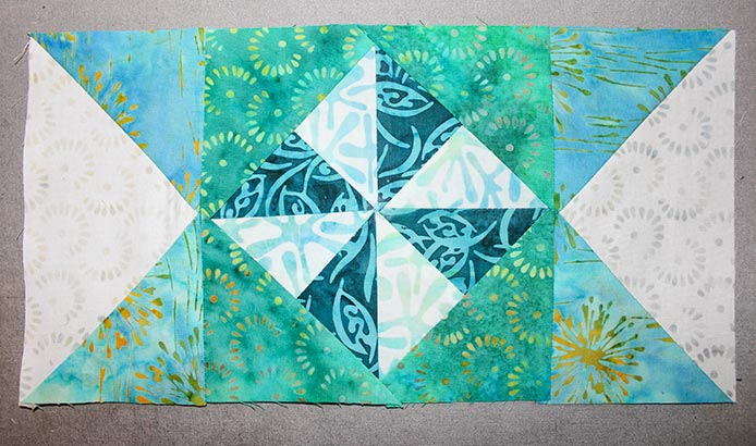 """Stitch 2 Step 6 rectangles on opposite edges of the Step 4 square to make a 3 ½"""" x 12 ½"""" rectangle."""