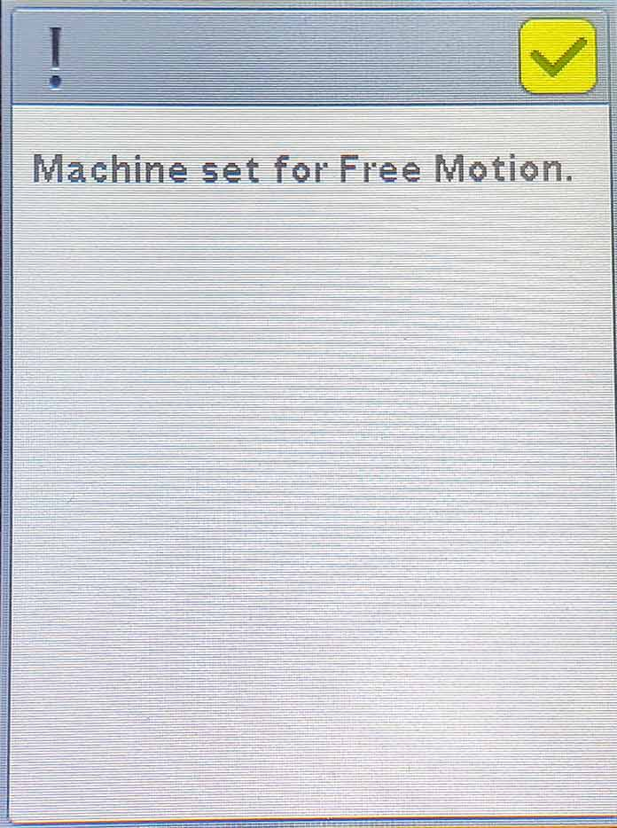 A pop-up message warning that the Husqvarna Viking Brilliance 75Q is in Free Motion mode