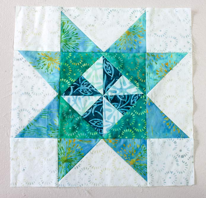 """Stitch 2 Step 7 rectangles on opposite edges of the Step 8 rectangle to make a 12 ½"""" square."""