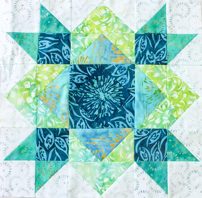 A completed Block 9. Spectrum QAL2020 Block 9 featuring The Little Girl in the Blue Armchair collection by Anthology Fabrics.