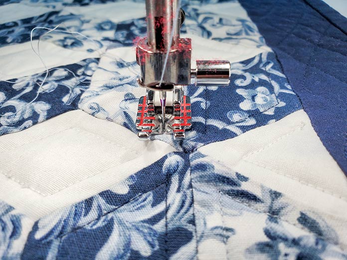 Using the Needle Stop Up/Down and Sensor Foot Down and Pivot to turn the corner for echo quilting on the Husqvarna Viking Brilliance 75Q sewing machine