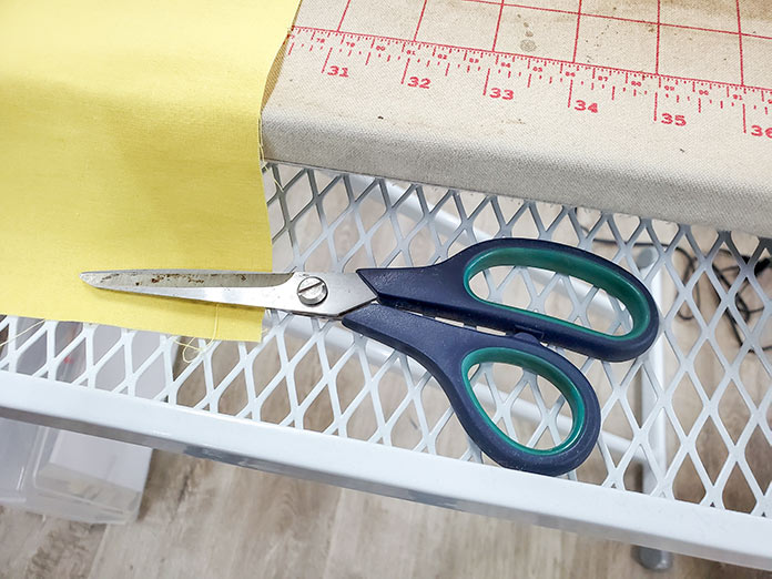 Scissors stored in the drawer of the Singer Ironing and Crafting station