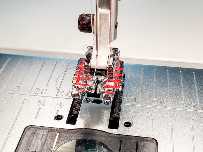 "The Quilter's ¼"" Piecing Foot P on the Husqvarna Viking Brilliance 75Q sewing machine"