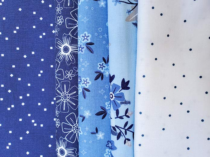 Five fabrics from the Blue Stitch collection by Christopher Thompson for Riley Blake Designs; QAL2020