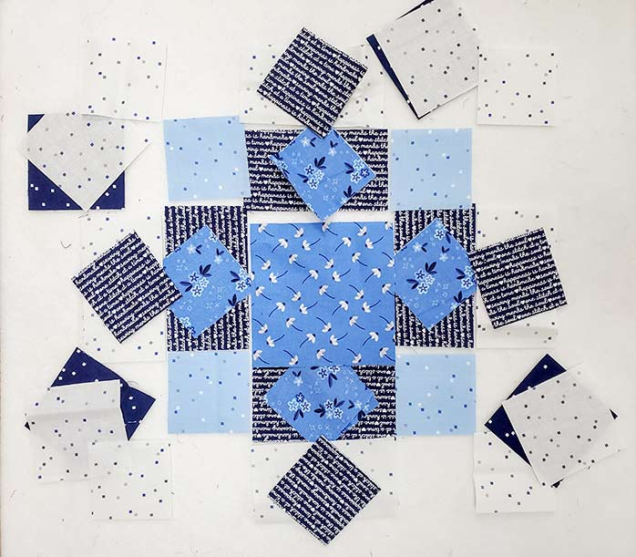 Pieces of blue and white fabric cut into squares and rectangles