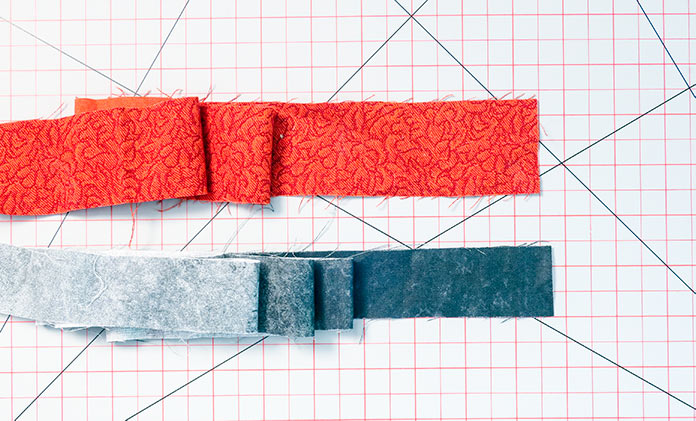 The two fabrics to be used to create a binding with a flange or faux-piping.