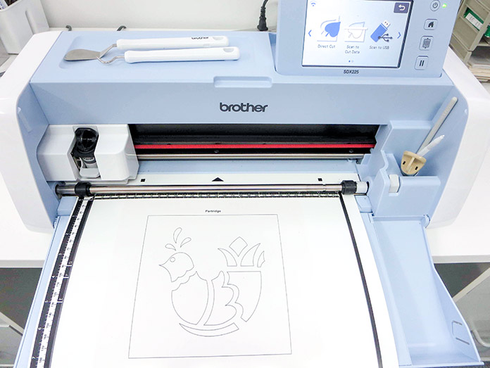 Place paper with design on scanning mat and load it into machine, Brother ScanNCut SDX225, Brother scanning mat, Brother stencil sheet, Brother hook and spatula set