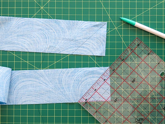 Marking your strips with a 45o diagonal line at each end will make easy work of finding the lines. Gütermann threads