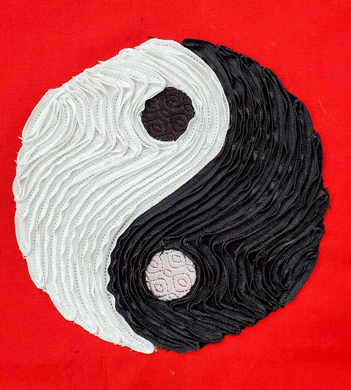 The final Yin Yang design with ribbon stitched over matching fabrics