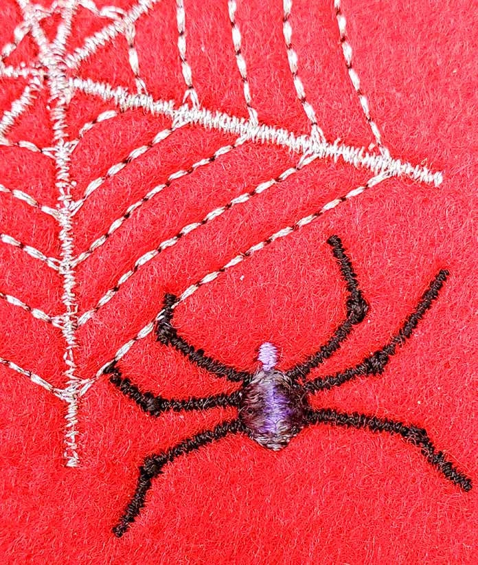 Close up of the Thread Velvet technique on the spider embroidery design.