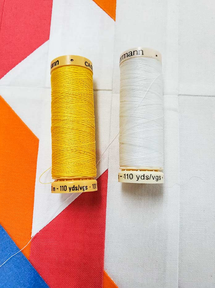 The thread colors for the quilting – yellow for the bobbin and white for the top; Gütermann Threads