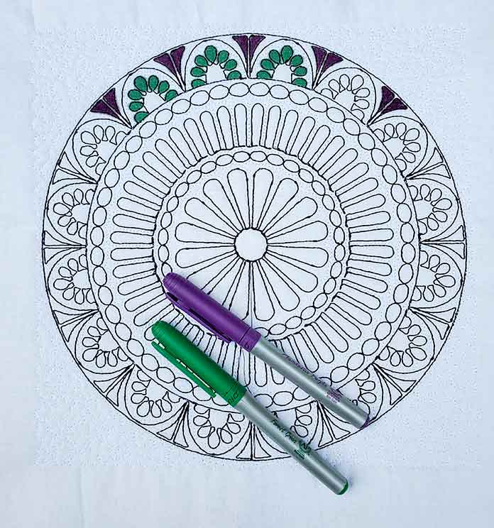 Using markers to color in an embroidered outline of a mandala; HV Designer EPIC 2
