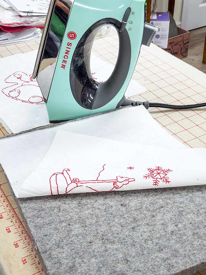 Pressing the hand embroidery block using a wood mat and the Singer SteamCraft PLUS iron. Husqvarna Viking Brilliance 75Q sewing machine, Husqvarna Viking Topstitch needle, Inspira Tear-A-Way Stabilizer, Singer Steam Craft Plus Steam Iron, Singer Ironing and Crafting Station