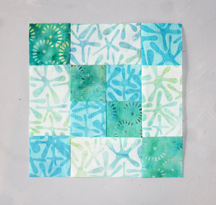 A Finished Step 15 block measuring 6½'' square. Block 4 featuring Little Girl in the Blue Armchair collection by Anthology Fabrics.