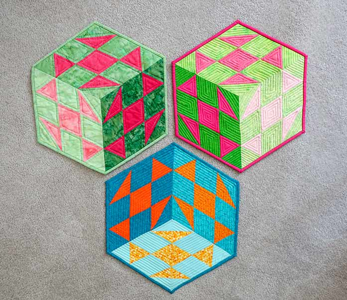 Three quilts showing binding with odd-angled corners.