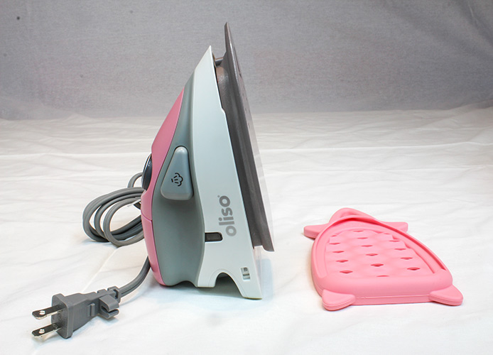 The Oliso M2Pro Mini Project Iron and the accompanying solemate silicone trivet.