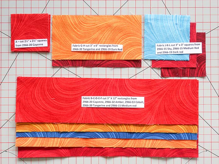 Here are the seven fabric colors needed for Block 3 cut, identified and ready for piecing Block 3. This Spectrum QAL 2020 quilt design features fabrics from the Wave Texture collection by Benartex.