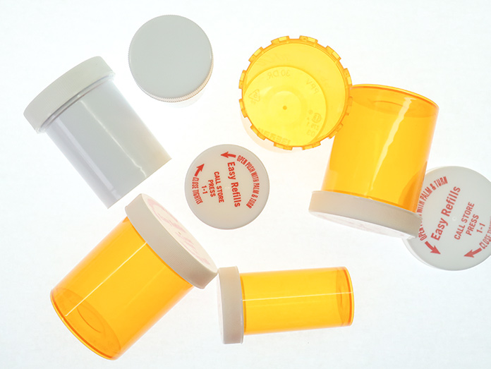 Empty pill bottles can be used to safely store used pins and needles.