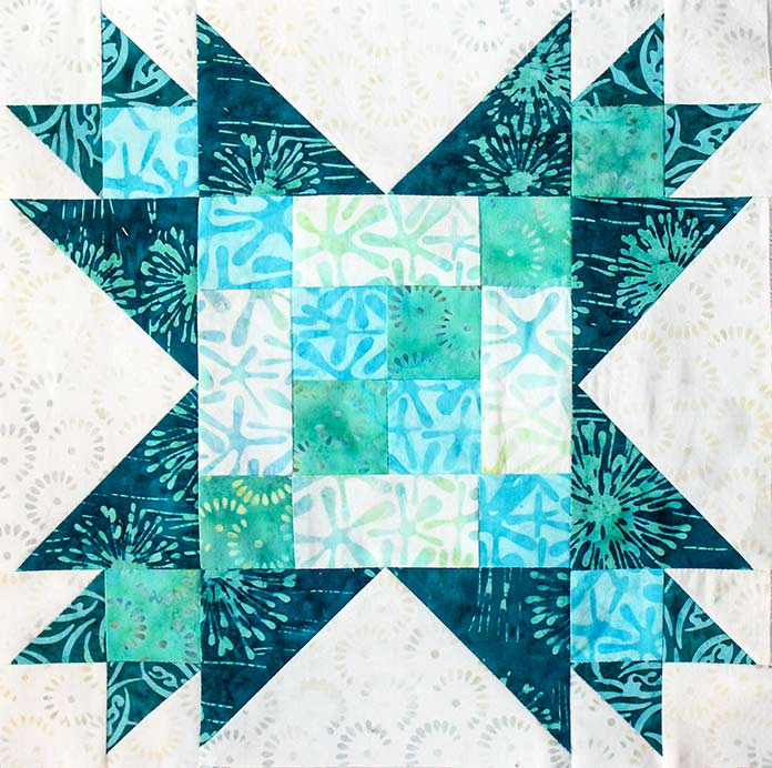 : A Finished Step 8 block measuring 12½'' square. Block 4 featuring Little Girl in the Blue Armchair collection by Anthology Fabrics.