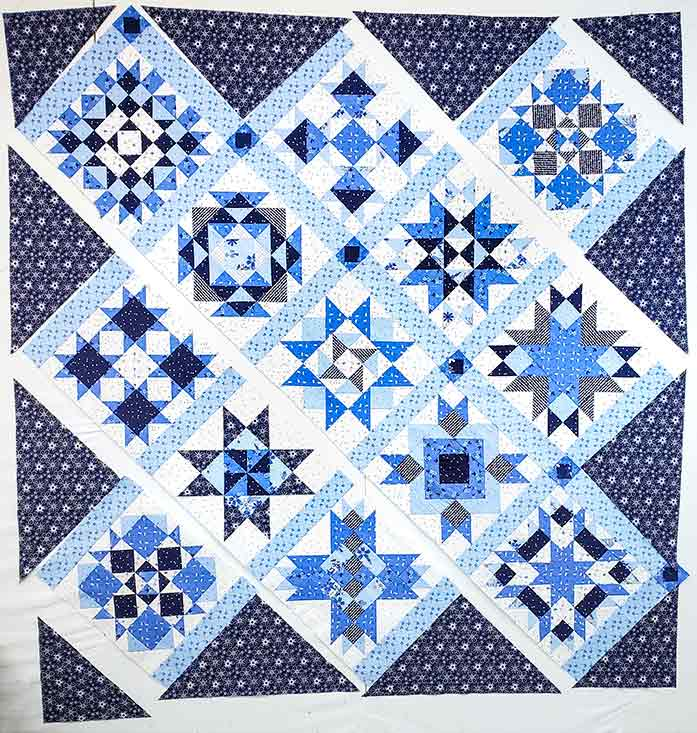 Placing the components of the blue and white quilt on a design wall. Spectrum QAL2020 made with the Blue Stitch collection by Riley Blake Designs