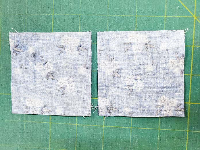 The squares for the half-square triangles are sewn and ready to be cut apart; Spectrum QAL2020, Blue Stitch Fabric Collection