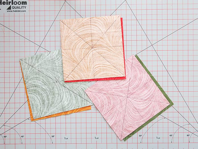 Drawing lines on the wrong side of one piece of fabric in each fabric pairs will help you construct half-square triangles quickly. Spectrum Quilt-A-Long quilt design featuring fabrics from the Wave Texture collection by Benartex.