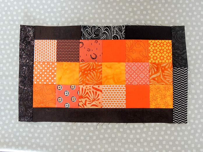 The center of the pillow is complete with the black inner border added.