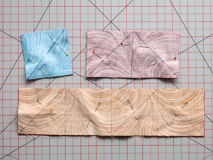 Vertical and diagonal lines are drawn on the back of one fabric piece in each fabric pair.