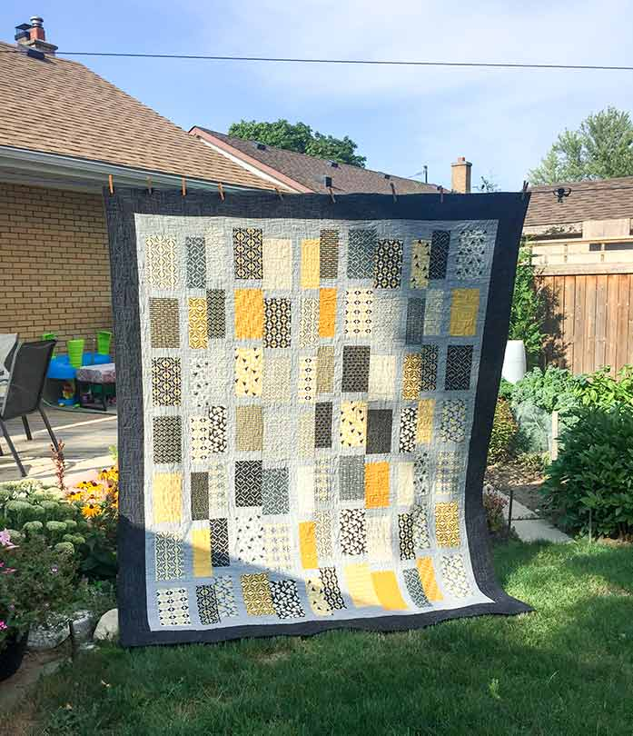 A quilting hanging in the yard