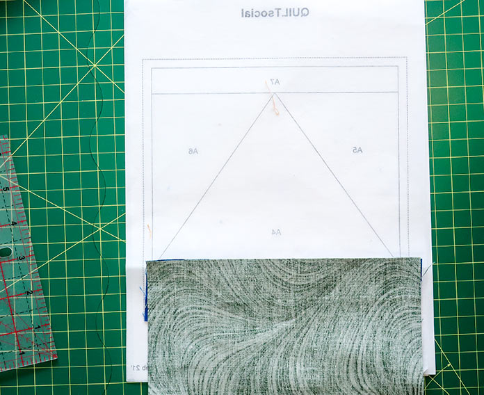 """The next step in foundation-piecing is to place the A3 fabric piece on top of the A1, A2 and A3 fabric pieces with right sides together. Using UNIQUE Quilt Template - 21 x 30cm [8¼"""" x 11¾""""], UNIQUE SEWING Quilt Template with Grid - 21 x 28.5cm [8¼"""" x 11""""], Gütermann threads, UNIQUE Dye Catcher and StitchnSew sheets."""