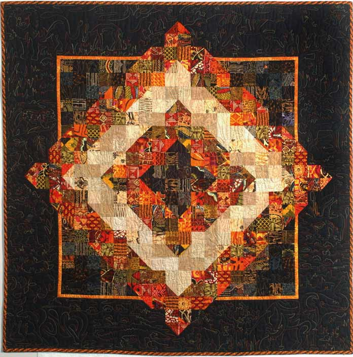 """Multicolored scrap African Safari quilt by Jean Boyd. Brother Innov-ís BQ3050 sewing and quilting machine, Mary Ellen's Best Press, Brother SA185 ¼"""" Piecing Foot with Guide, Brother SA125 ¼"""" Quilting Foot, Olfa square ruler, MuVit digital dual feed foot"""