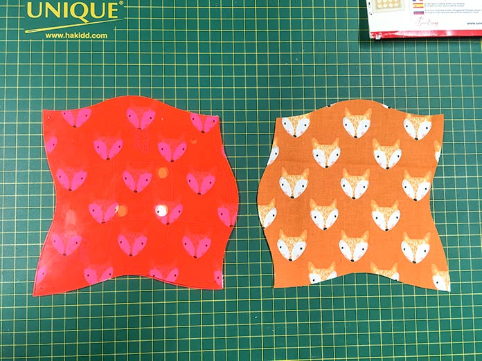 Be careful with directional fabric when using the Twisted Square Template. This fabric was folded in half with wrong sides together when it was cut, so one fabric square is backwards.