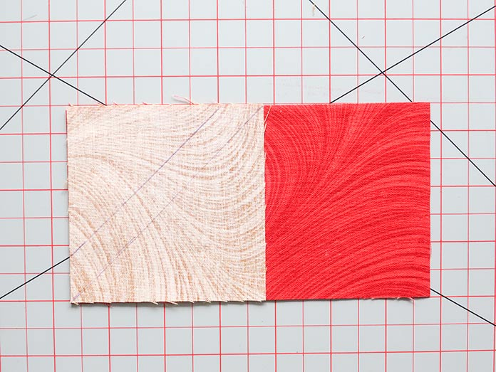 """With right sides together, place 3½""""x 3½"""" E fabric squares on each of the 3½""""x 6½"""" F fabric rectangles. Block 4, Spectrum QAL 2020 quilt design features fabrics from the Wave Texture collection by Benartex."""