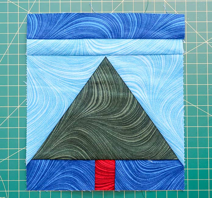 """The first step in completing the quilt top is to sew a 1½"""" x 7½"""" strip to the tops of four of the blocks. UNIQUE sewing and quilting template sheets, HEATNBOND Stitch n Sew EZ Print Quilt Block Sheets, UNIQUE folding cutting mat, SEW EASY Quilting Ruler"""