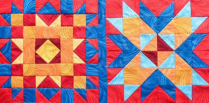 Two quilt blocks sewn together with a lattice piece in between. Spectrum QAL 2020 made with Benartex Wave Texture collection, Fairfield Quilter's 80/20 Quilt Batting