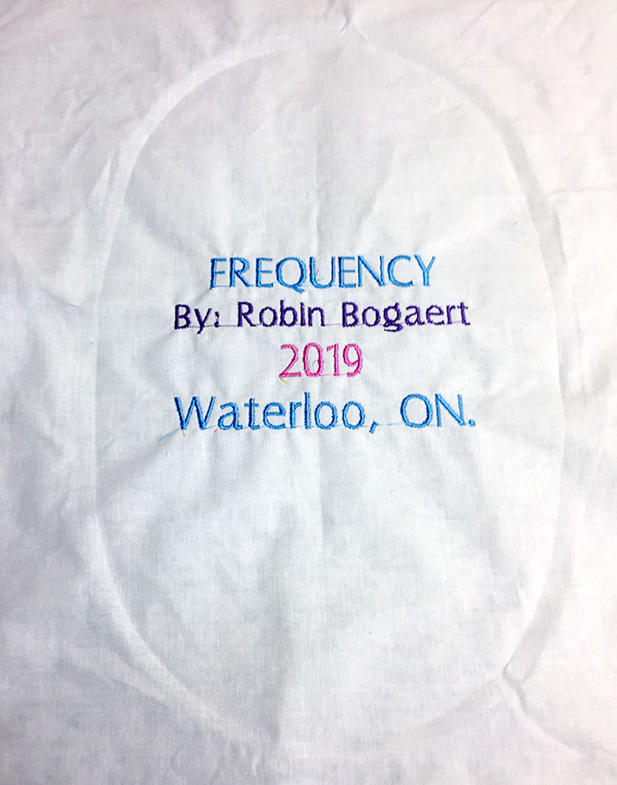 The completed machine embroidered label